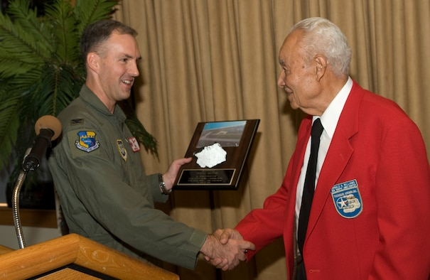 45th Operations Group Commander Col. Bernard Gruber presents Donald Williams with a piece of Patrick AFB runway as a token of thanks for speaking at the 45th Space Wing's Martin Luther King Jr. memorial luncheon Tuesday at The Tides. (U.S. Air Force photo by Jim Laviska)