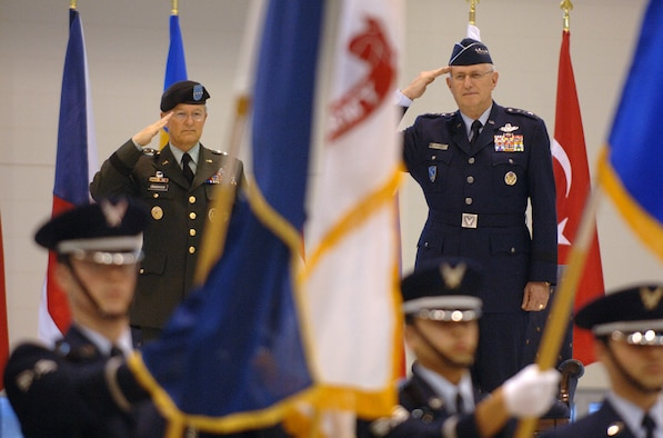General Roger A. Brady, Commander, United States Air Forces in Europe, and Gen. John Craddock, Supreme Allied Commander, Europe, salute during the Jan. 17 assumption of command ceremony at Ramstein Air Base, Germany.  As USAFE commander, Gen. Brady also has three other titles: commander, Allied Air Component Command Ramstein; air component commander, U.S. European Command, Ramstein AB, Germany; and director, Multinational Joint Air Power Competence Center, Kalkar, Germany. (Photo by Master Sgt. D. Scott Wagers, USAF)