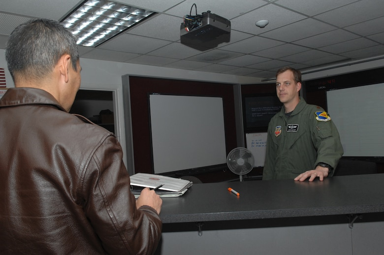 Maj. Joseph Rucker, 358th Fighter Squadron A-10 pilot, discusses flight operations on Jan. 15 at Davis-Monthan Air Force Base with Col. David Tanaka of 12th Air Force. The 358th FS prepares pilots for combat maneuvers, reconnaissance and surveillance missions. (U.S. Air Force photo/A1C Melissa Copeland)