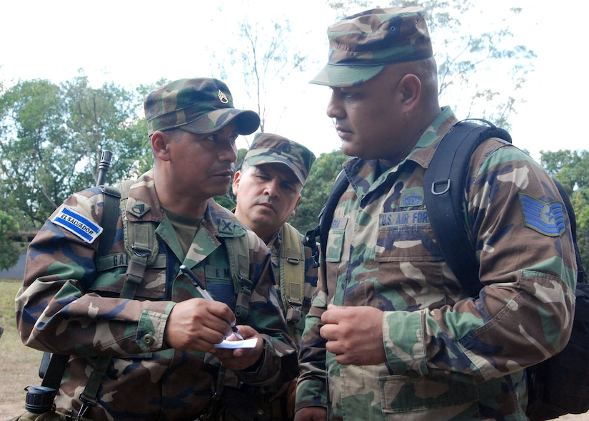 Tech. Sgt Herman Ybarra exchanges ideas with Salvadoran military members while they train for their upcoming deployment to support Operation Iraqi Freedom. Sergeant Ybarra was part of a U.S. task force from Soto Cano Air Base, Honduras, deployed to El Salvador to provide Salvadoran military members familiarization with U.S. equipment, tactics, techniques and procedures prior to their upcoming Operation Iraqi Freedom rotation. (U.S. Air Force Photo by Tech. Sgt. John Asselin)