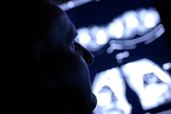 Maj. David Ives, 56th Medical Operations Squadron Diagnostic Imaging Flight commander views a chest CT scan. CT scans are used to locate abnormalities in the head, chest and abdomen. (photo by Staff Sgt. Christopher Hummel)