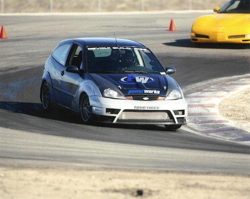 Technical Sgt. Chris Stout, 163rd  Reconnaissance Wing, March Air Reserve Base, Calif., concentrates as he goes in to a sharp turn during an Open Track Day event at Buttonwillow Raceway Park in California.  (U.S. Air Force photo submitted by Tech. Sgt. Chris Stout)