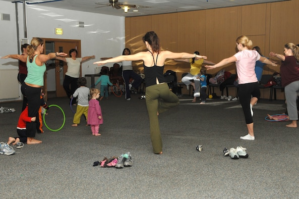 During the last few minutes of the Mommy and Me Yoga and Fitness class, Ms. Champagne, (far left), does some Yoga moves with the parents as the children watch, Jan. 18 at the Vogelweh Community Center. Ms. Champagne is the instructor for the class. (U.S. Air Force photo/Senior Airman Megan M. Carrico)