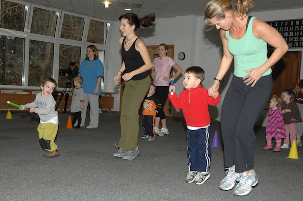 Renee Champagne, (right), does a fitness activity with her son, during the Mommy and Me Yoga and Fitness class, Jan.18, at the Vogelweh Community Center. Ms. Champagne is the instructor for the class. (U.S. Air Force photo/Senior Airman Megan M. Carrico)