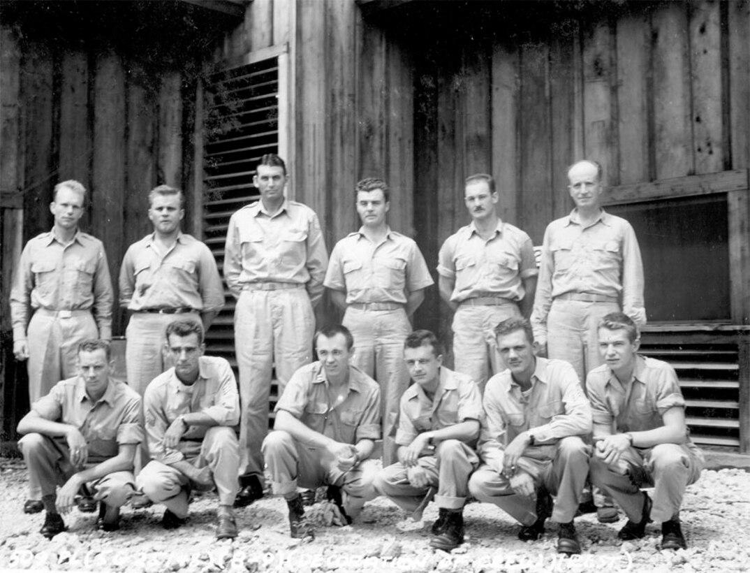 Standing: Lt. Jeppson, Capt. Lewis, Gen. Davies, Col. Tibbets, Maj. Ferebee, Capt. Parsons. Kneeling: S/Sgt Duzenbury, Sgt Stiborik, Maj. Van Kirk, S/Sgt Caron, Sgt Shumard, PFC Nelson