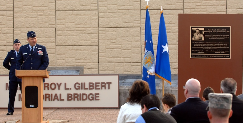 "Brig. Gen. Noel T. ""Tom"" Jones speaks to those in attendance at the grand opening of the Litchfield overpass dedicated to Maj. Troy L. Gilbert Jan. 25 at Luke Air Force Base, Ariz. Major Gilbert was killed in Baghdad Nov. 27, 2006. After 14 months of construction, people at Luke AFB can get from one side of the base to the other without ever leaving a gate, now that base officials have opened the overpass crossing Litchfield Road. (U.S. Air Force photo/Tech. Sgt. Raheem Moore)"