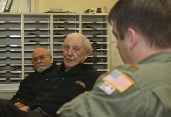 "Retired Air Force Col. Harold ""Hal"" Weekley (center) is the author of ""The Last Combat B-17 Driver."" He recently visited and spoke to the Airmen in the 700th Airlift Squadron as part of their Air Warrior series of speakers. The program is meant to inspire and foster the warrior spirit in squadron members."
