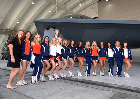 Andersen AFB, Guam -- The Denver Broncos cheerleaders pose in front of a  B-2 Spirit bomber after their visit with the 393rd Expeditionary Bomb Squadron, deployed from Whiteman Air Force Base, Mo. January 25, 2008. (U.S. Air Force Photo by Staff Sgt. Vanessa Valentine)