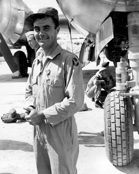 Col Tibbets Beams over award of the DSC upon completion of the first atomic bombing mission.