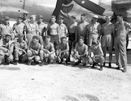 Tibbets' crew poses with aircraft maintainers