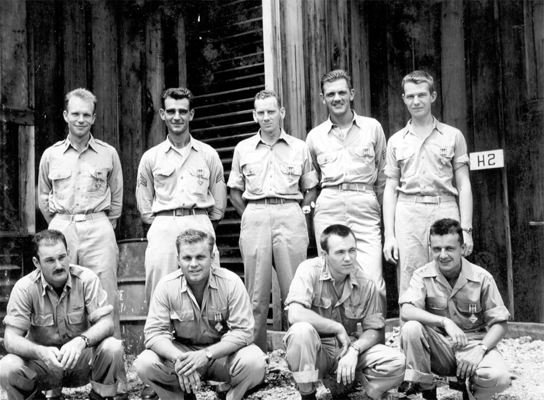 Col Tibbets' Crew of the Enola Gay Display their awards