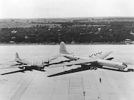 The Air Force's newest superbomber, the XB-36, compared with veteran B-29. The Air Force's huge six-engine bomber, the Convair XB-36, parked alongside a battle tested Boeing B-29, has a wingspan of 230 feet and the B-29, a wingspan of 141 feet. The length of the XB-36 is 163 feet; the B-29, 99 feet. The range of the XB-36 with a bomb load is 10,000 miles; the B-29 with a bomb load, approximately 4,100 miles. Though the Boeing B-29 Superfortress was the latest of the very heavy bombers, the improvements and the new developments incorporated in the Convair XB-36 show the remarkable technological advancement of the AF in the brief time that has elapsed since the end of the war. (31634 A.C.)