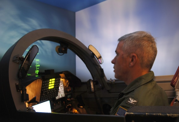Captain Russell Knight, commander of the Naval Air Station Meridian, Miss., flies a T-38 simulator Friday during his visit to Columbus AFB. Knight was visiting CAFB in hopes to build on relationship between the NAS and CAFB. (U.S. Air Force photo by Elizabeth Owens)