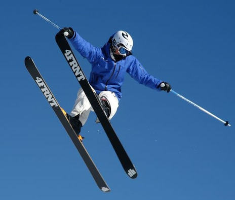 A SnoFest skier flies through the blue Rocky Mountain sky during the National Standard Race, or 'NASTAR' event Jan. 26. SnoFest, held in Keystone, Colo., is an annual ski weekend targeted at military members and their families. Approximately 3,400 servicemembers and their families attended the SnoFest 2008 event. (U.S. Air Force photo/Todd Ryan)
