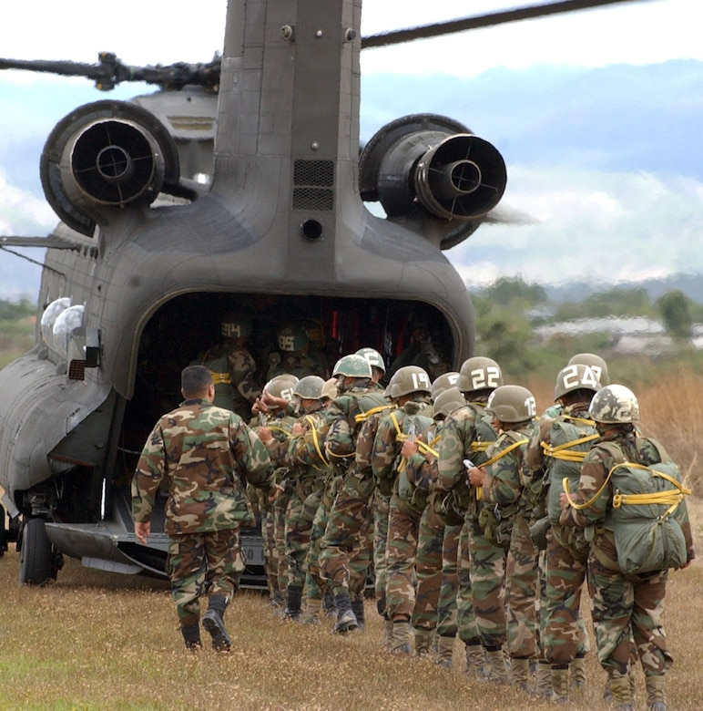 SOTO CANO AIR BASE, Honduras – Loading up eighteen per sortie, more than 250 Honduran eventually soldiers took their first step toward Airborne readiness after leaping from the back of an Army UH-60 Chinook helicopter Jan. 24 in a combined jump with U.S. Soldiers here.. (U.S. Air Force photo by Martin Chahin)