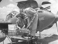 1st Lt H. A. Blood Examines Ammunition
