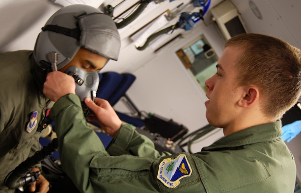 "LAUGHLIN AIR FORCE BASE, Texas – Airman 1st Class Brett Banwell, 47th Aerospace Physiology, trains to teach Specialized Undergraduate Pilot Training students with Senior Airman Brian Evans, 47th AP, how to wear an oxygen mask and helmet, while concentrating on breathing techniques and familiarization with the equipment. ""Aerospace Physiology helps pilots become familiar with how their body and mind will react when they get into the sky,"" said Airman Banwell ""We allow pilots to fly effectively!"" (U.S. Air Force photo by Airman 1st Class Sara Csurilla)"
