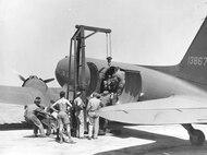 Oran, Algeria - Unloading motor froms transport at La Senia Field - June 1943.