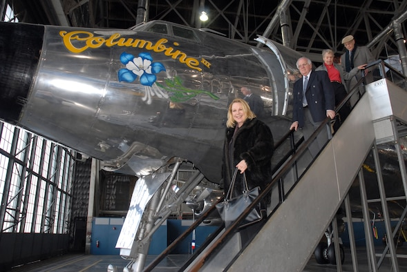 DAYTON, Ohio - Mary Eisenhower, granddaughter of former President Dwight D. Eisenhower, steps off the Columbine III, the presidential aircraft used by her grandfather until he left office in January 1961. The aircraft is on display in the Presidential Gallery at the National Museum of the U.S. Air Force. Other visitors accompanying Eisenhower include (l to r) Bill Vaughn, Joan Knoll and John Bosch. (U.S. Air Force photo)