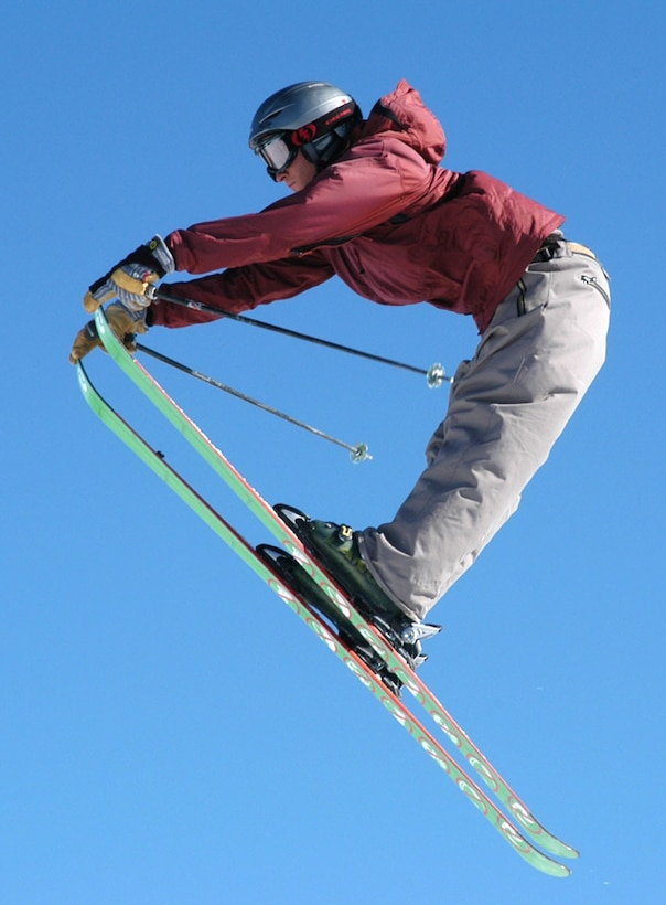 A SnoFest skier shows off their talents as they fly through the Rocky Mountain air Jan. 26. SnoFest, held in Keystone, Colo., is an annual ski weekend targeted at military members and their families. Approximately 3,400 servicemembers and their families attended the SnoFest 2008 event. (U.S. Air Force photo/Todd Ryan)