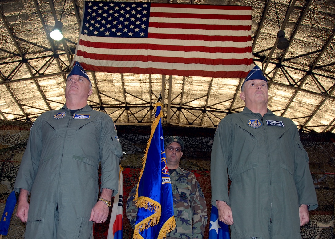 "OSAN AIR BASE, Republic of Korea – Gen. Carrol H. ""Howie"" Chandler, Pacific Air Forces commander, (left) and Lt. Gen. Stephen G. Wood, Seventh Air Force (Air Forces Korea) commander, stand at attention during the Seventh Air Force Re-designation Ceremony Jan. 30. (U.S. Air Force photo/Senior Airman Chad Strohmeyer)"