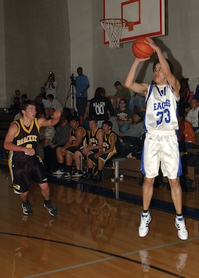 Shooting guard Mike Loar scores three of his 32 points in an 81-57 district victory Jan. 29 over Brackett High School. (USAF photo by Alan Boedeker)