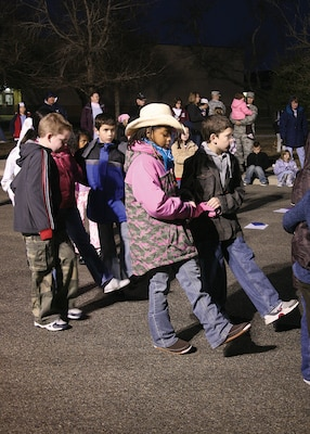 """A group of children from Lackland Elementary School perform the """"Cotton-Eyed Joe"""" during the school's Cowboy Breakfast on Jan. 25. (USAF photo by Robbin Cresswell)"""