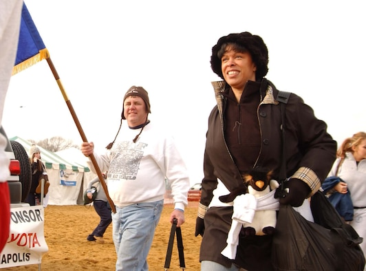 ANNAPOLIS, Md. -- Tech. Sgt. Warren Hiller, 459th Aircraft Maintenance Squadron, and Col. Stayce D. Harris, 459th Air Refueling Wing commander, walk toward the shore during the Maryland State Police Polar Bear Plunge Jan. 26. Team Andrews members of the 459th Air Refueling Wing and the 79th Medical Wing were among nearly 9,000 people who voluntarily jumped into the Chesapeake Bay at Sandy Point Park to raise money for Special Olympics Maryland.  (U.S. Air Force photo/Staff Sgt. Amaani Lyle)