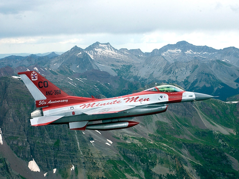 An F-16 aircraft painted in the color scheme of the original Air National Guard flight demonstration team takes flight from the 140th Wing, Buckley Air Force Base, July 26, 2006. This F-16 is flying in the skies above the southern Rocky Mountains.  The 140th Wing of the Colorado Air National Guard has reached the 50th anniversary as the only flying acrobatic Air National Guard team, and to commemorate this event they have painted an F-16 aircraft in the same paint scheme as the original F-86s were 50 years ago. (U.S. Air Force photo by Senior Master Sgt. John Rohrer)