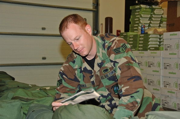 Senior Airman Neil Parks, 931st Air Maintenance Squadron, inspects the contents of his mobility bag in preparation for his deployment to Turkey. The first rotation of AMXS deployers are currently serving in Turkey in support of Operation Iraqi Freedom/Operation Enduring Freedom. (U.S. Air Force photo/Senior Airman Connor Burkhard)