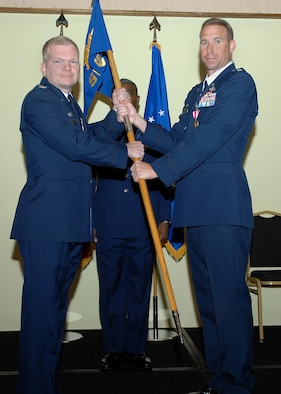 Lt. Col. Alex Gaines 36th Serivces Squadron commander passes off the 36th SVS guidon to Col. Mark Talley 36th Mission Support Group commander relinquishing command and deactivation the squadron July 1 here. The 36th SVS and the 36th Mission Support Squadron were both deactivated and merged creating the 36th Force Support Squadron.(U.S. Air Force by Airman 1st Class Nichelle Griffiths)