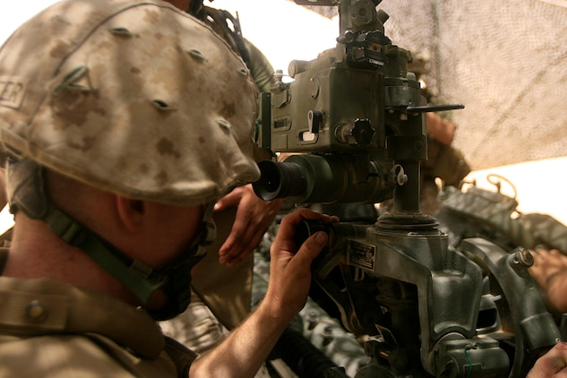 CAMP BUEHRING, Kuwait (July 3, 2008)--Pfc. Michael J. Schoepfer, a Marine with India Battery, Battalion Landing Team 2/5, 15th Marine Expeditionary Unit, sights in his M777 155mm Howitzer.::r::::n::Schoepfer, along with the rest of India Btry were conducting sustainment training on one of the many training ranges here.::r::::n::The Camp Pendleton, Calif., based 15th MEU is currently in Kuwait conducting sustainment training. (Official USMC photo by Staff Sgt. TG Kessler)(Released)::r::::n::