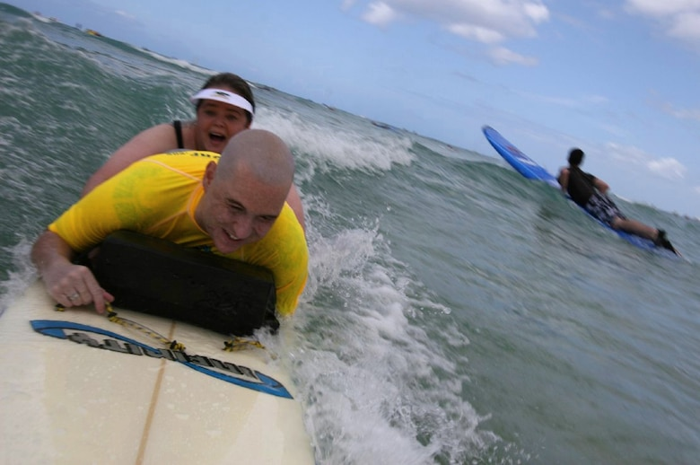 Catching a wave or two, Matt and Annette enjoy a second honeymoon in Hawaii following the renewal of their marriage vows. (courtesy photo)