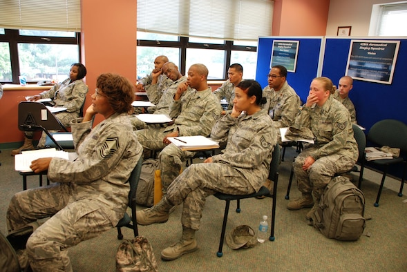 ANDREWS AIR FORCE BASE, Md. -- Members of the 459th Aeromedical Staging Squadron listen to briefings upon their return from Ali Al Salem Air Base, Kuwait, in May. The unit directly participated in the rescue of passengers and drivers when three buses collided approximately one half mile outside the main gate of the base. (U.S. Air Force photo/Tech. Sgt. Amaani Lyle)