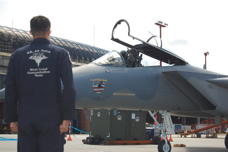 Staff Sgt. Darren Pautz, an F-15 crew chief with the F-15 West Coast Demonstration Team performs pre-flight communications with the pilot, Capt. Sam Joplin, during the RIO NEGRO air and trade show in Medellín, Colombia. The Demonstration Team celebrated 25 years of service during RIO NEGRO by performing for audiences at the Medellín International Airport for six days, thrilling an audience estimated at more than 100,000 Colombian citizens. (Photo by Capt. Nathan Broshear)