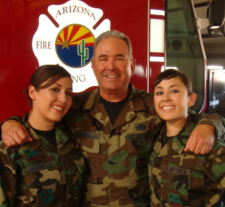 Staff Sgt. Erika Jaramillo, Chief Master Sgt. Bobby Jaramillo and Senior Airman Andrea Jaramillo. Both daughters joined the wing after their father served several years here. Chief Jaramillo now serves at Arizona Joint Force Headquarters in Phoenix. (Air National Guard photo by Staff Sgt. Ashley Karas)
