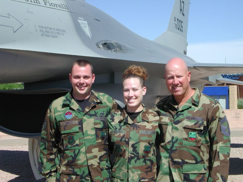 Staff Sgt. Michael Whitt, Staff Sgt. Ashley Karas and Senior Master Sgt. Brian Karas. Ashley and her stepbrother, Michael, joined to follow in their father's footsteps.
