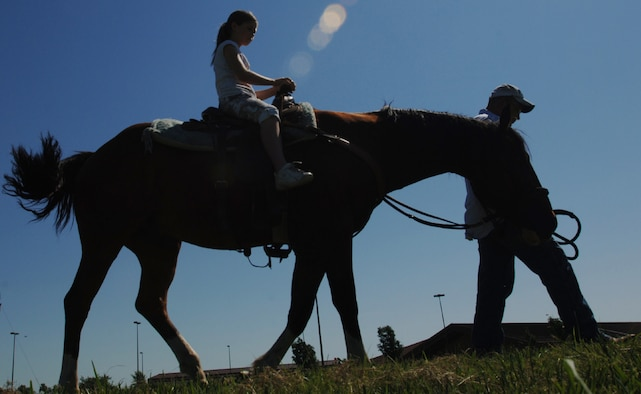 A young family member of the 931st Air Refueling Group rides a horse led by Tech. Sgt. Tyrel Askren, 931st Security Forces, at the Group's Family Day Picnic in 2007.  Volunteers are needed to support this year's picnic, scheduled for the September Unit Training Assembly. Contact Tech. Sgt. Shannan Hughes at 316-759-6082 for more information. (U.S. Air Force photo/Tech. Sgt. Jason Schaap)