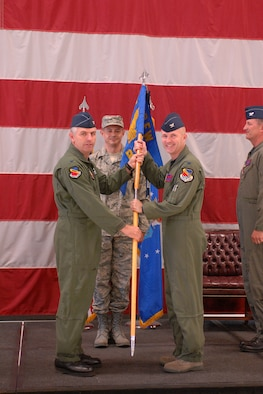 Col. Jeffrey Snell (right) accepts command of the 388th Range Squadron in a ceremony here June 19. The colonel will direct Department of Defense operations on the 2.3 million-acre Utah Test and Training Range and manage approximately 100 personnel.  The 388th Fighter Wing Commander, Col. Scott Dennis (left),  presided over the unit's change of command. (U.S. Air Force photo by Alex Lloyd)