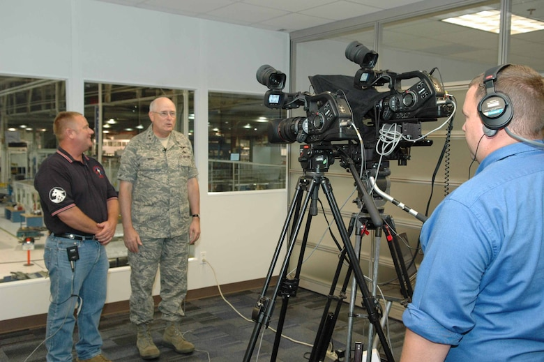 Tony Channel, site manager for KMAR Industries, videotapes Oklahoma City Air Logistics Center Commander Maj. Gen. Loren Reno and Johnny Johnson, an aircraft towing supervisor with the 566th Aircraft Maintenance Squadron June 26 in Bldg. 3001, as part of a special message to the work force by General Reno.  The video will soon be on the Tinker home page.  (Air Force photo by Ron Mullan)