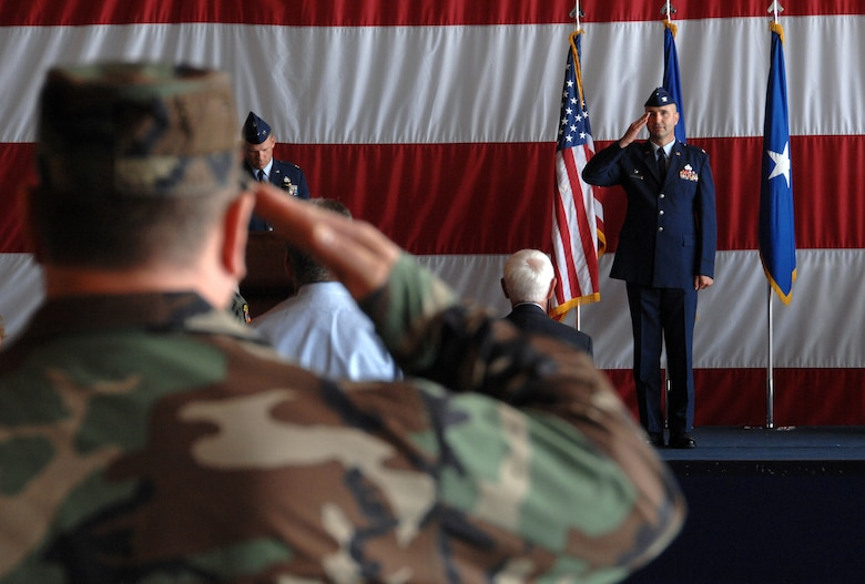 Col. Terry A. Parsons, 55th Maintenance Group commander, returns a salute to the formation at the June 27 change of command ceremony here. (U.S. Air Force Photo/Josh Plueger)