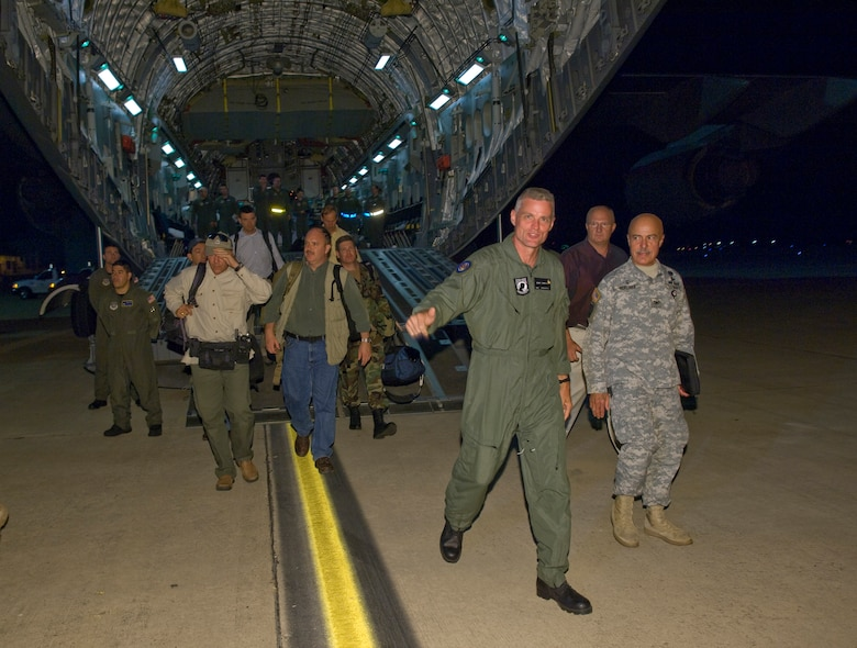 Keith Stansell, a contractor who was rescued after being held hostage by rebels in Colombia, steps off the ramp of a C-17 Globemaster III onto U.S. soil at Lackland Air Force Base, Texas at 11:31 p.m., July 2. The aircraft is stationed at Travis AFB, Calif., and the crews came from various bases such as Charleston AFB, S.C., and Pope AFB, N.C.  (U.S. Air Force photo/Lance Cheung)