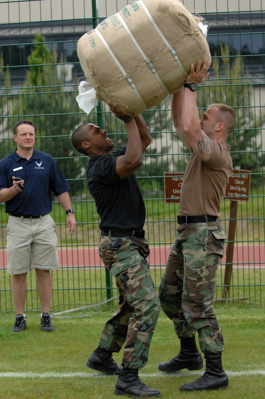 Staff Sgt. Christopher Clawson and Staff Sgt. Dwight Scott press a bail of rolled towels during the Total Fit challenge hosted by the Health and Wellness Center, Ramstein Air Base, Germany, May 21, 2008. They were able to win the competion with the time of 9:49. (U.S. Air Force photo by  Airman 1st Class Nathan Lipscomb) (RELEASED)