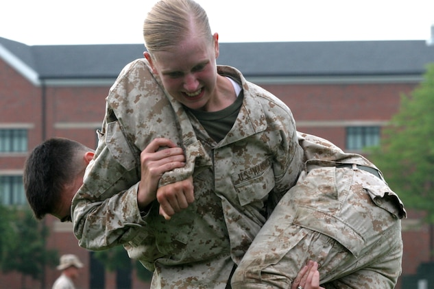 Marines perform the fireman's carry event of the Combat Fitness Test during a trial exercise on July 8. The CFT is being implemented throughout the Marine Corps to test Marines' ability in combat related exercises.