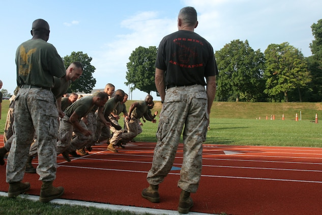 Marines with Security Battalion, Weapons Training Battalion and Marines from Marine Barracks Washington charge from the starting line of the 880-yard movement to contact event of the Combat Fitness Test. The three units participated in a trial CFT on July 8. The CFT is being implemented throughout the Marine Corps to test Marines' ability in combat related exercises.