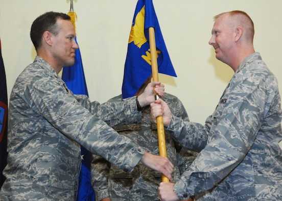 Col. Bret Klassen, 36th Maintenance Group Commander presents the 36th Maintenance Squadron guidon to Maj. Joseph Shirey signifying the change of command July 10 here. Major Shirey arrives here from the North Atlantic Treaty Organization Component Command Headquartes, Izmir, Turkey. (U.S. Air Force by Airman 1st Class Nichelle Griffiths)
