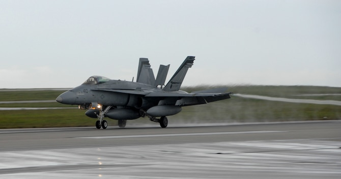 A U.S. Navy F/A-18 Hornet, from Strike Fighter Squadron 94 at Naval Air Station Lemoore, Calif., lands at Andersen Air Force Base July 9. The F/A-18 is a strike fighter aircraft flown by the Navy and Marine Corps.   Aircrews from 12 Hornets used Andersen as a resting point during their flight from California to Australia where they will participate in an exercise with the Australian Air Force.  (U.S. Air Force photo by Airman 1st Class Courtney Witt)