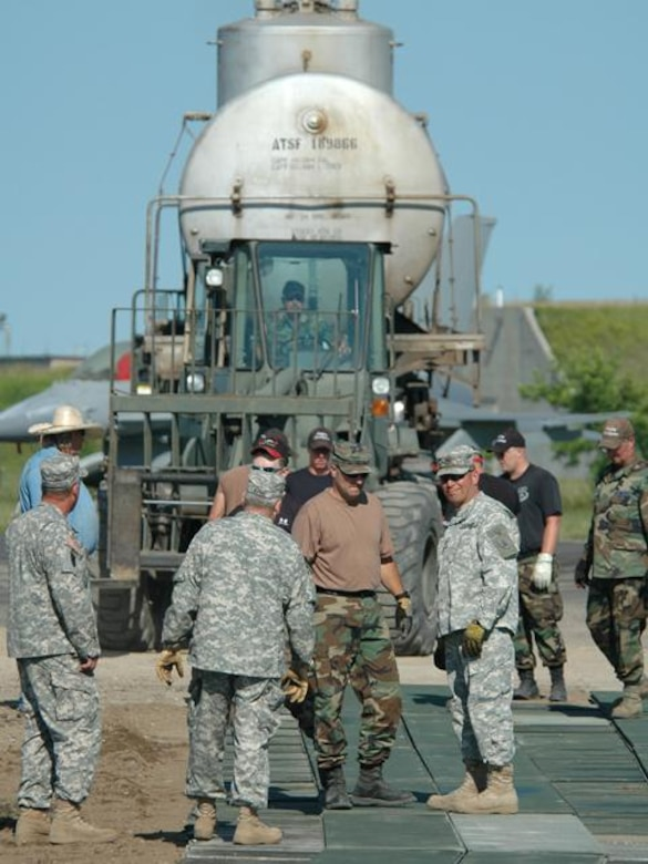 N.D. Air and Army National Guard members work to set up railcars donated by Burlingon Northern Santa Fe Railroad on Wed. Jul 9, 2008 at the 119th Wing, N.D. Air National Guard.  The two railcars will be used for training at the N.D. Air National Guard base.