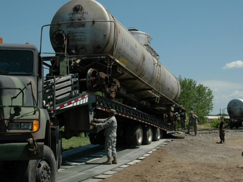 N.D. Air and Army National Guard members transfer a railcar from the Spur railroad track on the N.D. State University Campus in Fargo N.D. to a flatbed truck on Wed. Jul 9, 2008.  The two railcars, donated by Burlington Northern Santa Fe Railroad, will be used for training at the N.D. Air National Guard base.