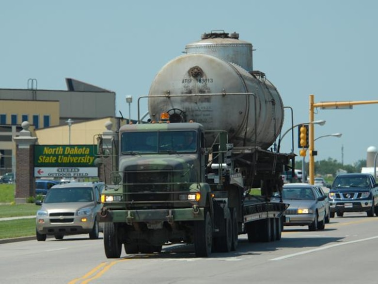 N.D. Air and Army National Guard members transport a railcar via a flatbed truck down 19th Ave. in Fargo N.D. on Wed. Jul 9, 2008.  Two railcars, donated by Burlington Northern Santa Fe Railroad, will be used for training at the N.D. Air National Guard base.